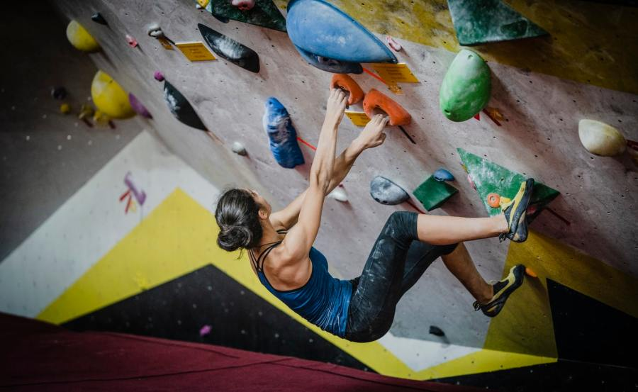 Woman rock climber at an indoor climbing gym