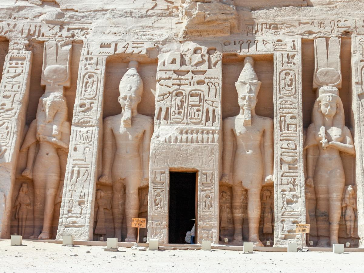 Photo of Egyptian temple statues by AussieActive on Unsplash
